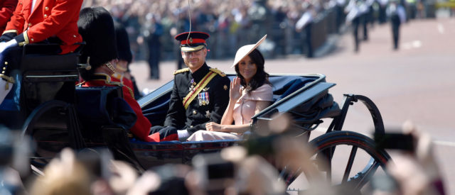 The Duke and Duchess of Sussex ride in a carriage at the annual Queen's Birthday Parade