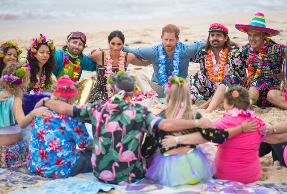 On Day Four of their Royal Tour in Australia, The Duke and Duchess meet with a mental health support group on Bondi Beach and sit in a circle arms in arm with the members of this encouraging community. They each wear bright colours and flower leis - a symbol of the happiness this group aims to bring