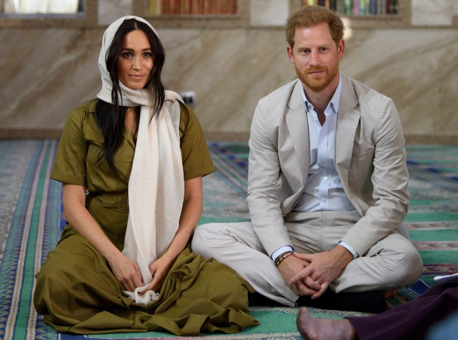 During their Southern Africa tour in 2019, The Duke and Duchess of Sussex visit the oldest Mosque in South Africa as they sit cross legged talking to community members.